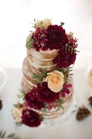 Naked Wedding Cake With Deep Red Flowers