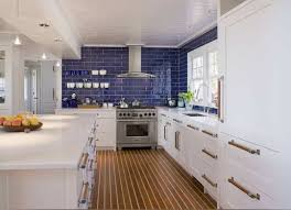style kitchen with blue subway tile backsplash and white