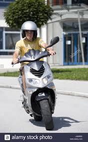 Teenagersboymotor Scootergohelmetview Stock Photo Royalty