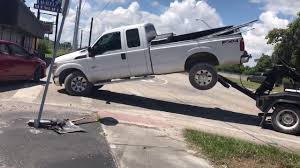 Watch Florida Man Try To Break Free From Repo Man's Tow Truck - YouTube