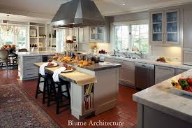 traditional kitchen with flat panel cabinets by christy blumenfeld