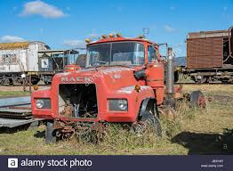 Old Red Mack Truck In A Vehicle Graveyard Stock Photo: 144531935 - Alamy