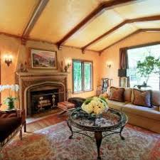 Yellow Living Room With Vaulted Ceiling And Old World Charm
