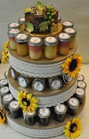 Little Tipsy Cakes Displayed In The Tower With A Rustic Birthday Cake On TopGuests Were Exited To Take Jar Home