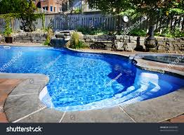 Residential Inground Swimming Pool Backyard Waterfall Stock Photo ... An Easy Cost Effective Way To Fill In Your Old Swimming Pool Small Yard Pool Project Huge Transformation Youtube Inground Pools St Louis Mo Poynter Landscape How To Take Care Of An Inground Backyard Designs Home Interior Decor Ideas Backyards Chic 35 Millon Dollar Video Hgtv Wikipedia Natural Freefrom North Richland Hills Texas Boulder Backyard Large And Beautiful Photos Photo Select Traditional With Fence Exterior Brick Floors