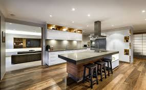 Kitchen Features Large Complex Island Including Natural Wood Tone Base White Cabinetry