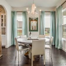 Inspiration For A Farmhouse Dark Wood Floor And Brown Enclosed Dining Room Remodel In Dallas