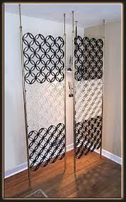 tension pole screen in brass mid century room dividers