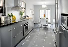 light gray kitchen cabinets and homey kitchen with the