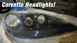 how to open c6 corvette headlights