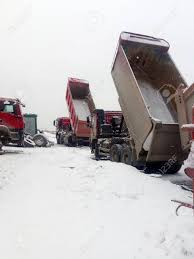 100 Area Trucks Repair Of Dump In Winter Stock Photo Picture And