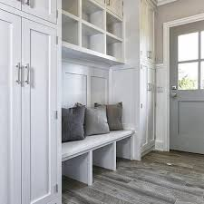 mud room with wood like floor tiles design ideas
