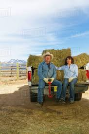 Hispanic Couple Sitting On Back Of Truck Full Of Hay - Stock Photo ... Truck Carrying Hay Rolls In Davidsons Lane Moore Creek Near Hay Ggcadc Flickr Bale Bed For Sale Sz Gooseneck Cm Beds Parked Loaded With Neatly Stacked Bales Near Cuyama My Truck And The 8 Rx8clubcom On A Country Highway Stock Photo Image Of Horse Ranch Filescott Armas Truckjpg Wikimedia Commons Hits Swan Street Richmond Rail Bridge Long Delays Early Morning Fire Closes 17 Myalgomaca Oversized Load On Chevy Youtube Btriple Trucks Allowed Oxley To Ferry Relief The Land A 89178084 Alamy