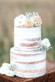 Rustic Wedding Cakes A Thinly Frosted White Cake Topped With Pale Petals By Angel Delights