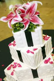 four tier white wedding cake with pink Tiger Lillies wedding cake topper