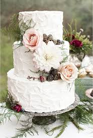 A Three Tiered White Wedding Cake