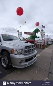 Dodge Truck And A Huge Inflated Dinosaur At The Entrance To A Stock ... New Used Chrysler Jeep Dodge Ram Dealer Redlands Buy American Cars Trucks Agt Your Official Importer Halifax Dealership Bowie In Tx Wise County Mount Airy Cdjr Fiat Indianapolis And Bayshore Baytown Bob Howard Oklahoma City Okc Karmart Cjdrf York Auto Crawfordsville In Ken Garff West Valley