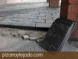 Colocaci³n de pizarra para suelos exteriores e interiores