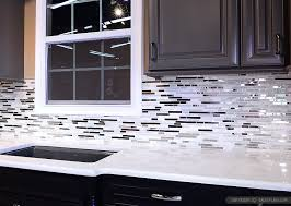 kitchen elegant black cabinet gray marble stone metal backsplash