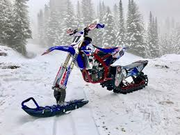Snow Bike Racing Is Now Officially A Thing - BikeBandit.com 4x4 Tracks For 4runners Fj Cruisers More Rubber Snow Adventure Sport Rentals 5092410232 Atv Track Over The Tire Right Systems Int Jeeprubiconwnglerlarolitedsptsnowtracksdominator John Deere Gators Get On Track American Truck Announces That South Dakota Police Department Farm Show Magazine Best Stories About Madeitmyself Shop Fifteen Cars Ditched Tires Autotraderca Mattracks Cversions Gmc Unveils Sierra 2500hd All Mountain A Denali With Tracks Custom You Can Buy The Snocat Dodge Ram From Diesel Brothers