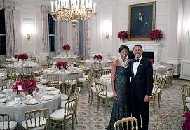President Barack Obama And First Lady Michelle Pose In The State Dining Room Of