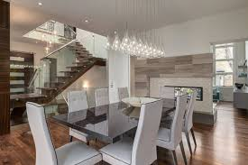 Contemporary Dining Room With Two Way Fireplace And Custom Stair Modern