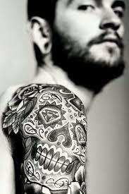 Cool Skull Tattoo Design On A Mans Arm