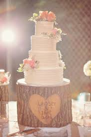 Tree Stump Cake Stand Is Adorable With Clusters Of Fresh Flowers On The