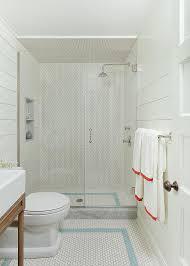 white hex tiled floor with blue hex border tiles cottage bathroom