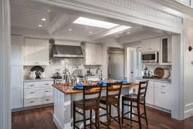 White Modern Stove Near Wooden Table Renovating Cape Cod House