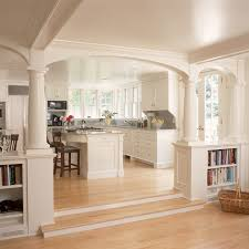 Best Floor For Kitchen And Living Room by White Kitchen And Breakfast Room With Fireplace And Arches