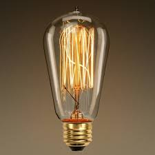 why does an incandescent lightbulb filament get while the wire