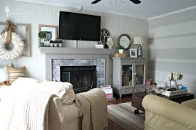 Fireplace And Rustic Decor Family Room With Wreath