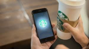 The coffee chain is testing cashless transactions and eyeing a mobile integrated digital payments system