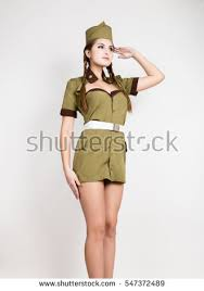 Sexy Fashionable Woman In Military Uniform And Forage Cap Put A Hand To Her
