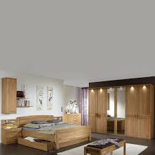 wiemann münster schlafzimmer kompaktbett mit bettschubkasten 6 türiger drehtürenschrank 2 nachtkonsolen hängeschrank und ankleidebank in eiche