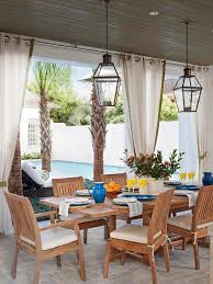 Covered Patio Dining Space With Carriage Lanterns