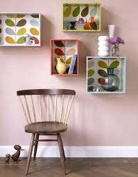 The Sophisticated Stack Of Dark Brown Crates On Floor Against A Plain White Wall Filled With Items Even Earth Globe Is