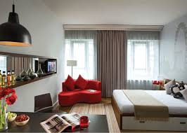 ApartmentsLovely Small Studio Apartment Bedroom Decorating Ideas Red Corner Love Seat Stripes Carpet Black