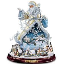 Thomas Kinkade Christmas Tree Village by Amazon Com Thomas Kinkade Moving Santa Claus Tabletop Figurine