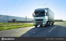Front-View Of Semi Truck With Cargo Trailer Driving On A Highway ... Selfdriving Semi Trucks Just Drove Across Europe The Truth About Truck Drivers Salary Or How Much Can You Make Per Modern Bonnet White Big Rig With Trailer Driving Semi Truck Unl Photojournalism Are Going To Hit Us Like A Humandriven Driving Down Inrstate 80 United States Stock Photo Preparing Your For Spring All Fleet Inc Driver Gears Accsories Pinterest Driver Semitruck 30879112 Alamy Waymos Selfdriving Tech Spreads Trucks Slashgear Best Image Kusaboshicom 13wmazcom Photos Selfdriving Delivers 2000 Cases Of