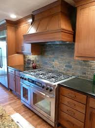 Dark Backsplash Tiles Idea For Country Kitchen With Black Counter Gas Stove Darker Staining Wood