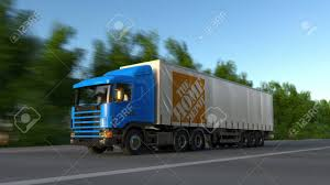 100 Home Depot Truck Freight Semi With The Logo Driving Along Forest
