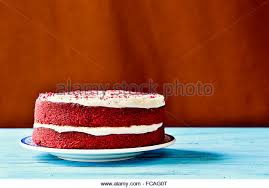An Appetizing Red Velvet Cake On A Rustic Blue Wooden Table