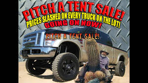 PITCH A TENT SALE! USED LIFTED TRUCKS, SUV'S AND DIESEL TRUCKS FOR ...