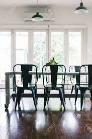 Contemporary Vintage Styled Light Bright Dining Room With Bifold Doors Vertical Stock Photo