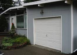 Hand made custom Swing Carriage House Garage Door and REAL