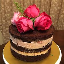 Rustic Naked cake Rustic cake Chocolate cake with strawberry buttercream decorated with fresh flowers
