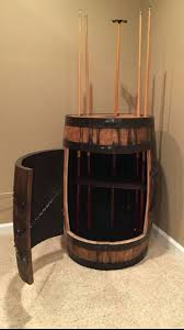 Bourbon whiskey barrel pool cue holder with cabinet and shelf