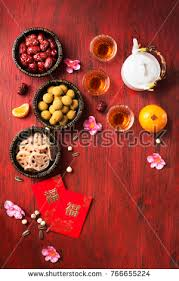 Flat Lay Chinese New Year Food And Drink Still Life On Red Wooden Rustic Background